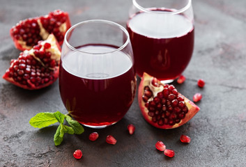 Pomegranate juice with fresh pomegranate fruits