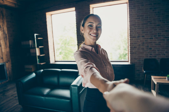 Firtst point person view of her she nice-looking attractive cheerful cheery confident lady top hr specialist director shaking hand join team at modern industrial loft interior style work place station