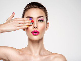 Beautiful fashion woman with a colored nails. Attractive white girl with multicolor manicure.