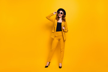 Full length body size photo beautiful amazing funky she her toothy lady perfect look tourism shopping store mall laughter wear specs formal-wear costume suit isolated yellow bright background