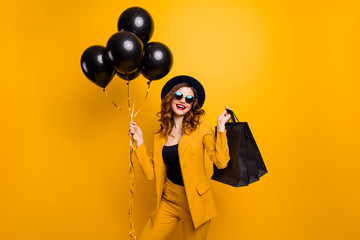 Close up photo beautiful amazing she her lady carry packs perfect look buy buyer present gift balloons birthday sale discount wear specs formal-wear costume suit isolated yellow bright background