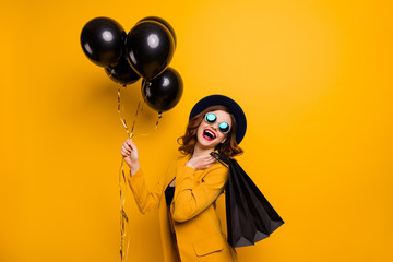 Close up side profile photo beautiful she her lady laugh laughter carry packs perfect look buy buyer present gift birthday discount wear specs formal-wear costume isolated yellow bright background Wall mural