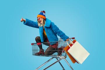 Fototapeta Young woman approving crazy shopping obraz