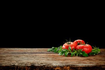 Fresh vegetables on wooden desk and black space