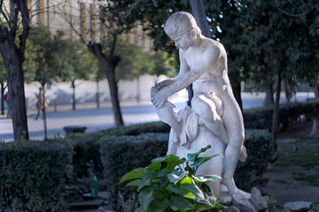 "Athens, Attica / Greece. ""Young Fisherman"". Marble statue located at Zappeion Hall area in the National Garden of Greece"