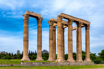 Athens, Attica / Greece. The Temple of Olympian Zeus, also known as the Olympieion or Columns of the Olympian Zeus, is a former colossal temple at the center of Athens. Sunny day, cloudy sky, nobody