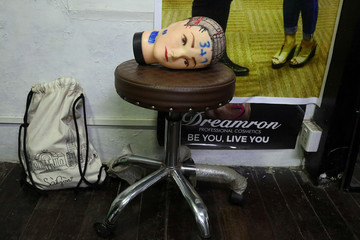 A mannequin head used for hairdresser training is pictured at the classroom in Yangon