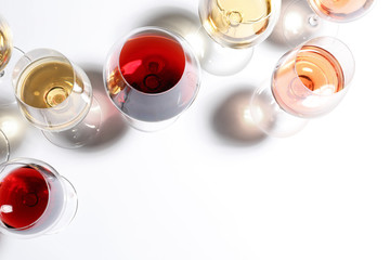 Different glasses with wine on white background, top view Fototapete
