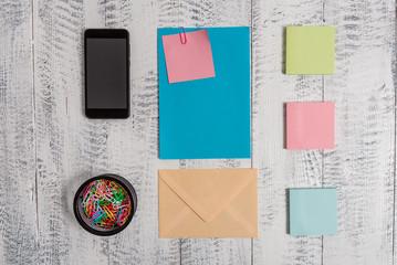 Envelope letter smartphone note clips notepads wooden vintage background