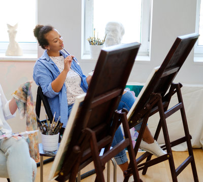 African american student working in a painting studio