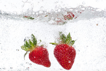 Printed roller blinds Splashing water ripe red strawberries are thrown and dropped into sparkling water, many bubbles