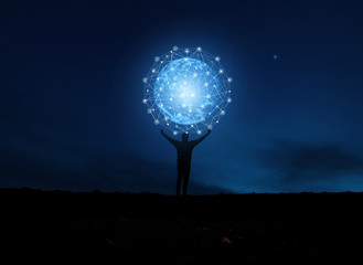 concept global network connection in hands on night sky background .soft focus picture .Blue tone concept