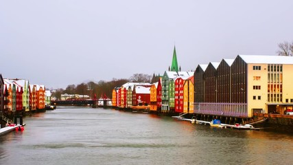 Wall Mural - Trondheim, Norway. City center of Trondheim, Norway during the cloudy winter day. Time-lapse of historical colorful building and grey cloudy sky, pan