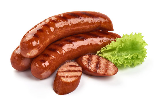 Grilled pork sausages with lettuce, close-up, isolated on white background