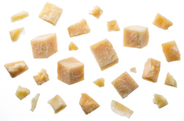 Wall Mural - Parmesan cheese cubes and parmesan crumbs on white background. Clipping path.