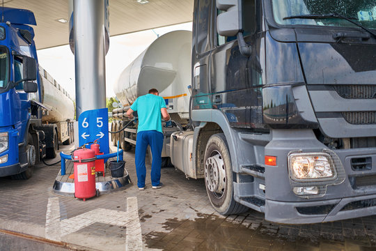 man fills the truck with fuel