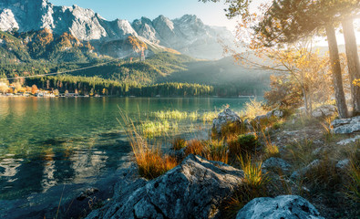 Impressive Autumn landscape The Eibsee Lake in front of the Zugspitze under sunlight. Amazing sunny day on the mountain lake. concept of an ideal resting place. Eibsee lake in Bavaria, Germany