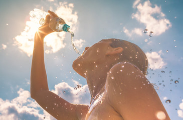 Woman drinking cooling off in the summer heat  Wall mural