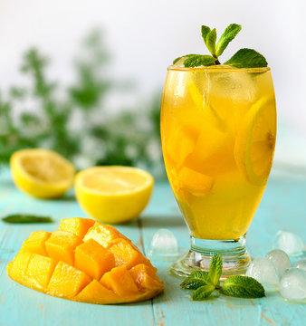 Yellow iced tea with pineapple, lemon