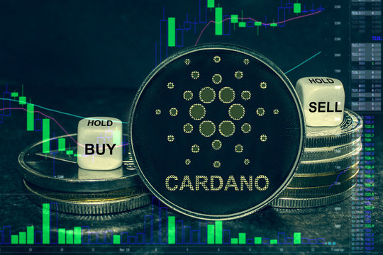 coin cryptocurrency ada cardano stack of coins and dice. Exchange chart to buy, sell, hold.