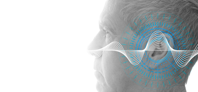 Hearing test showing ear of senior man with sound waves simulation technology