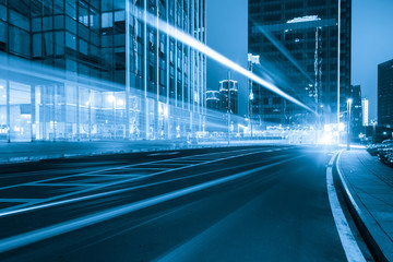 Fotomurales - abstract image of blur motion of cars on the city road at night,Modern urban architecture