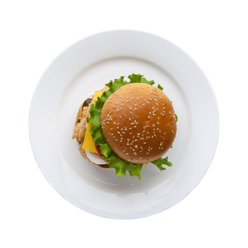 hamburger with lettuce in a plate on a white background, top view