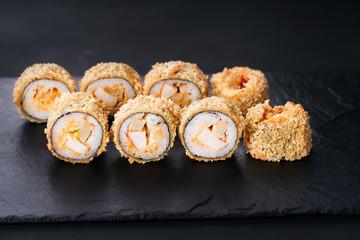 Fototapeta Japanese sushi tempura maki chicken and tamago roll on slate. Japanese traditional fusion food style, restaurant menu obraz