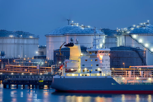 Liquid Natural Gas storage tanks and tanker, Port of Rotterdam