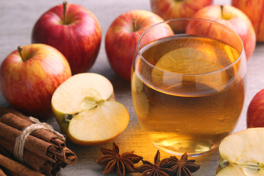 A glass with juice and apples