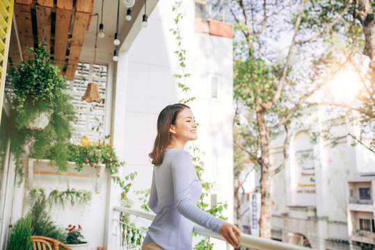 Woman enjoy her coffee at the balcony
