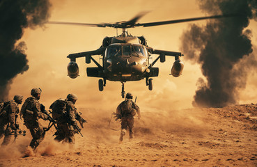 Military soldiers are running to the helicopter in battlefield