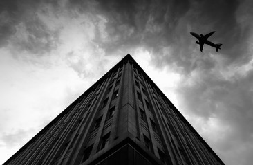 Airplane over Building in the City black and white creativity Picture