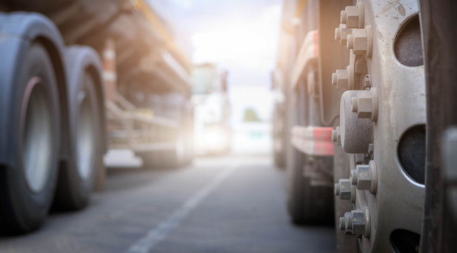 Transportation concept of truck,Freight transport and vehicle concept,Close up  wheels truck  in parking,Spot focus.