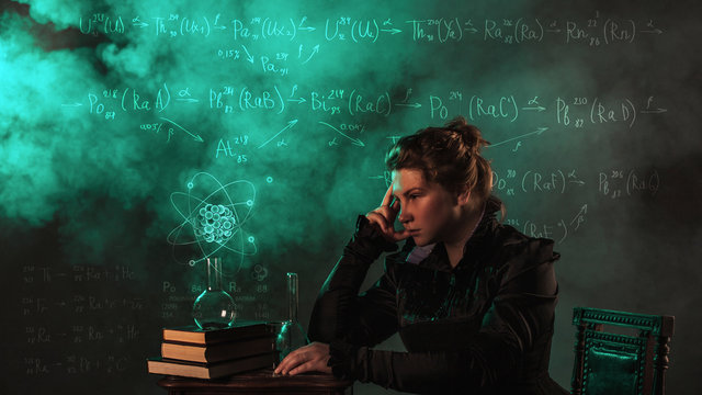 Scientist researcher on abstract background of schemes and formulas. History of science, great physical discoveries