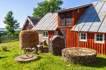 Wall Mural - Farmhouse with firewood piles at the summer