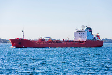 Red Tanker ship sailing on the sea