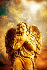 Wall Mural - angel archangel over starry sky in praying gesture