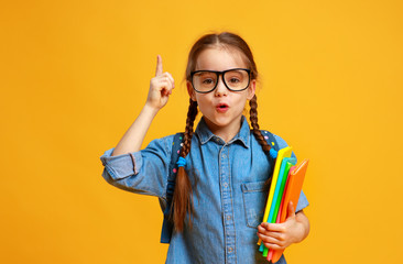funny child school girl girl on yellow background    .