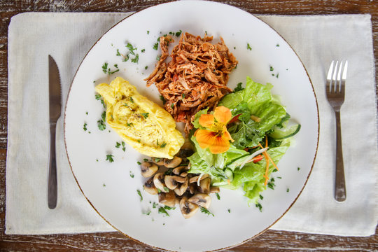 Shredded chicken served with scrambled eggs and mushrooms, Casual fine dining restaurant food