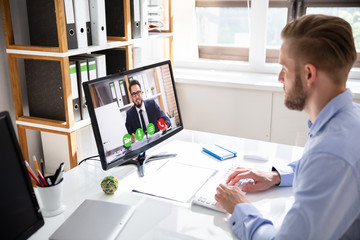 Businessman on a video or conference call on his computer