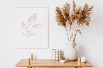 Stylish korean interior of living room with white mock up poster frame, elegant accessories, air plant, wooden shelf and vase with flowers. Minimalistic concept of home decor. Template. Bright room.