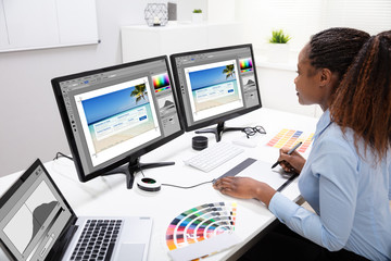 Designer Editing Photos On Computer