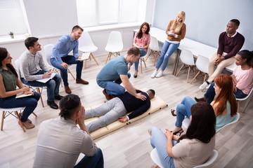 Male Instructor Showing Massage Technique