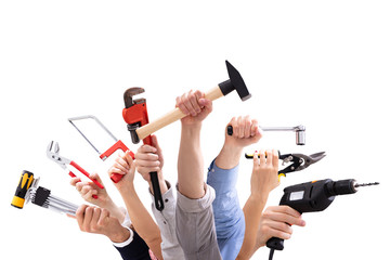 Group Of People's Hand Holding Carpentry Tools