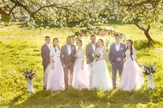 Wedding ceremony in the apple orchard in spring