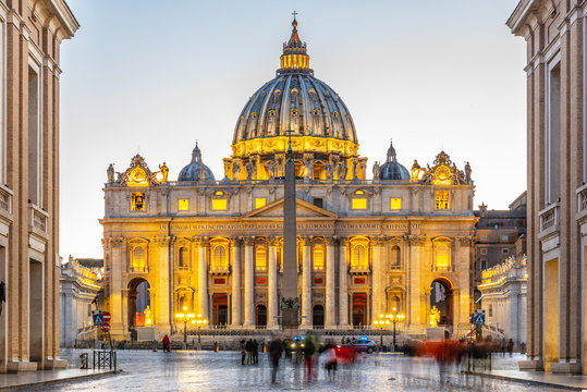 Vatican City by night. Illuminated dome of St Peters Basilica and St Peters Square at the end of Via della Conciliazione. Rome, Italy