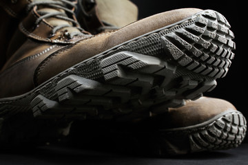 Closeup photo of military boots and protector.