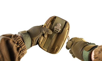 Soldier arms holding military tactical pouch.