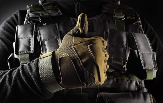 Soldier in tactical gloves showing like gesture front view closeup.